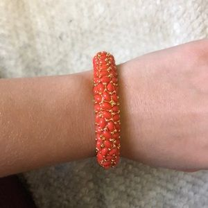 Coral colored stretch bangle bracelet